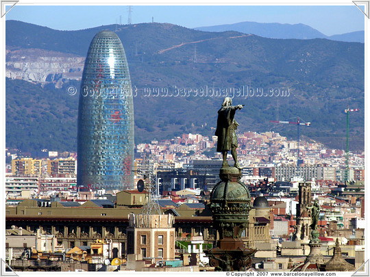 Barcelona Torre Agbar and Columbus statue