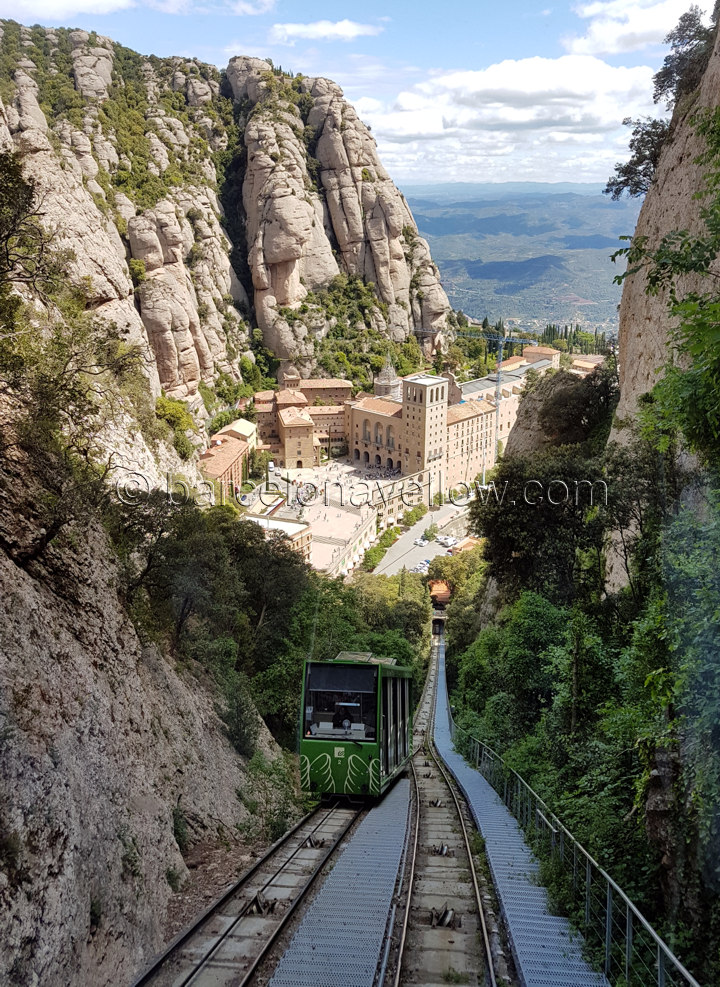 Montserrat funicular train Barcelona with monastery and basilica